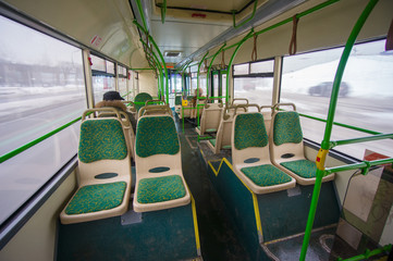 Interior of modern city bus. Wide angle shot of back side with s