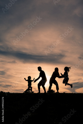 Family having fun at sunset in park