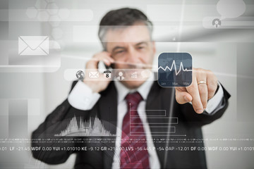 Businessman selecting stock application from touchscreen menu