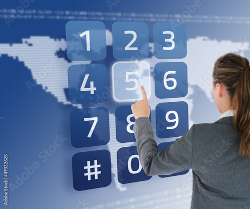Businesswoman entering pin on digital keypad