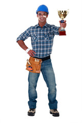 Happy builder holding trophy