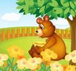 A bear sitting in a beautiful garden