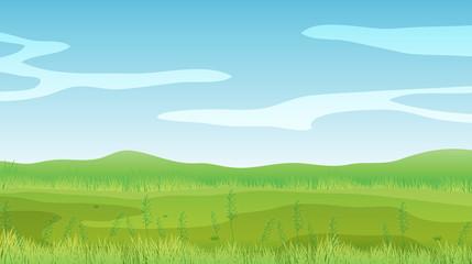 An empty field under a clear blue sky