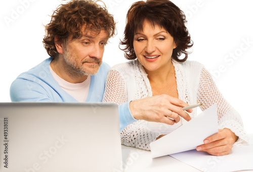 Old couple discussing some paper