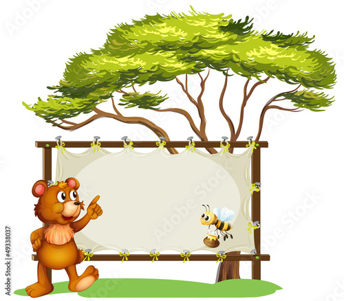 A notice board, a bear and a honey bee
