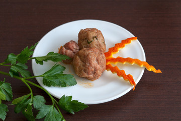 noisettes with parsley on a plate
