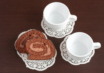 chocolate roll on napkins and cup