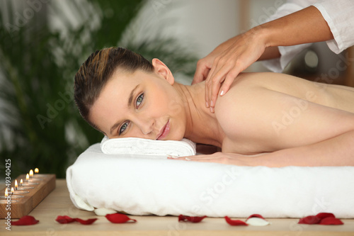 Young woman enjoying a rose scented back massage