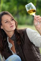 winemaker watching glass of wine