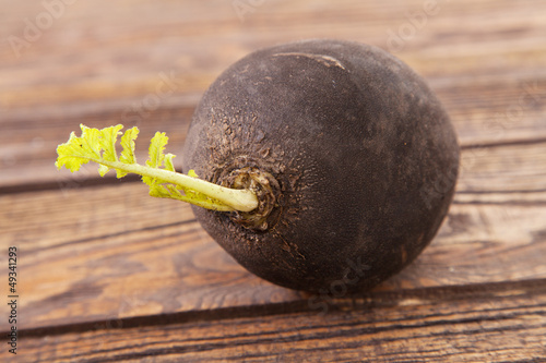 Black radish on a wooden table