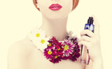 Beautiful redhead girl with flowers and perfume