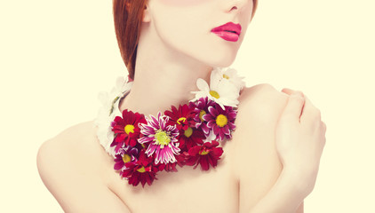 Beautiful redhead girl with flowers