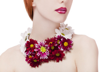 Beautiful redhead girl with flowers