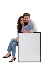 Couple with blank picture frame