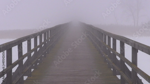 empty wooden bridge and morning  fog