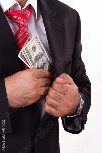 Man Putting Money into Pocket