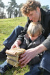 Family and son building an object