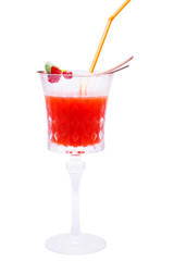 Red cocktail with decorated raspberry and cranberry