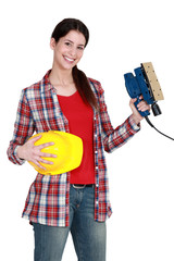 Woman holding a sander