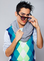 Fashionable and sweet guy in sunglasses