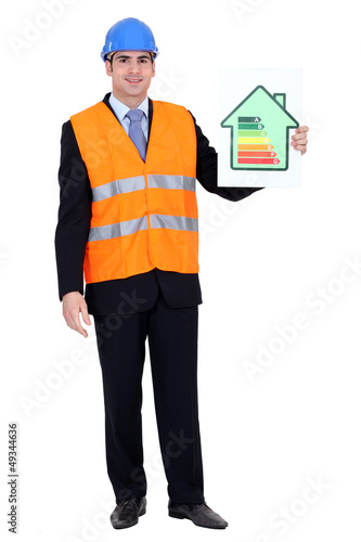 Engineer holding up efficiency chart