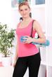 Beautiful middleaged woman in fitness wear