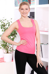Beautiful middleaged woman in fitness wear