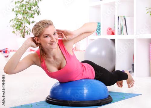 Beautiful middleaged woman doing fitness