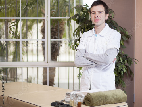 Handsome young therapist waiting for his next patient