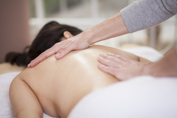 Chubby woman getting a massage at a health and beauty spa