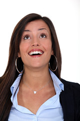 business woman laughing and looking up