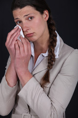 young woman shedding tears