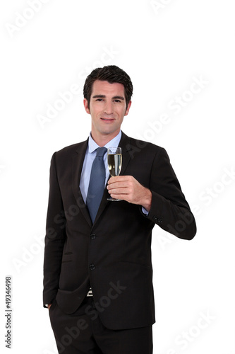 Businessman holding champagne glass