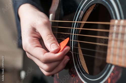 Female hand playing acoustic guitar.guitar play.