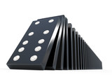 Black dominoes falling over - close up