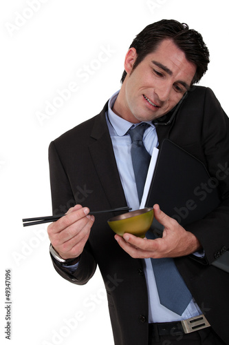 Businessman eating Chinese food