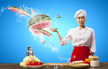 Asian female cook with knife