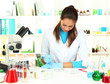 Young scientist with Petri dish in  laboratory.