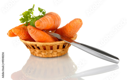 carrots with knife  in basket isolated on white