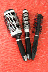 Black combs on color background