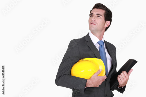 Architect with helmet in hand