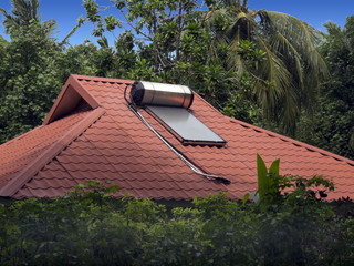 Solar water heater sits on the roof of a homes