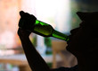 Silhouette of man drinking alcohol, close up