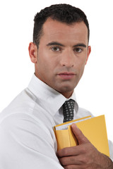 Businessman protective of document