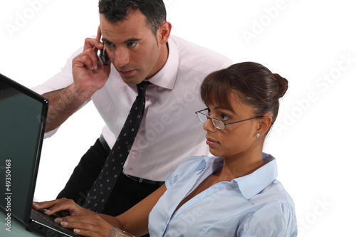 Businessman and assistant  with phone and laptop