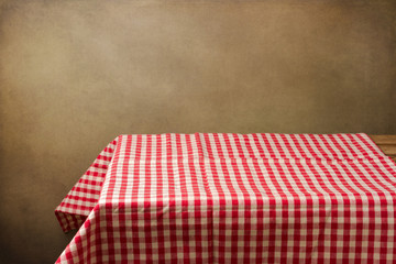 Background with table and tablecloth over grunge background