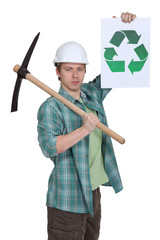 young bricklayer with pickaxe showing recycling logo