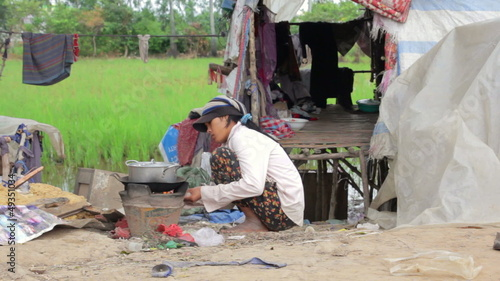 Mother preparing lunch in slums in stewpot