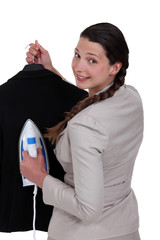 Woman ironing jacket