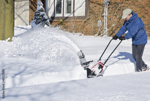 Man Using Snowblower to Clear Snow